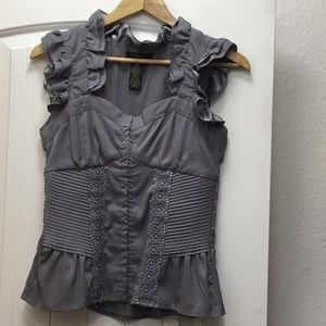 Form fitting grey sleeveless blouse